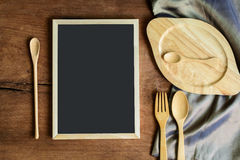 Wooden utensil in kitchen on old wooden background with blackboa Royalty Free Stock Photography