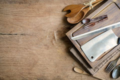 Wooden utensil in kitchen on old wooden background Stock Image