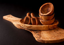 Wooden utensils. Cutting board, bowls and scoop Royalty Free Stock Photography