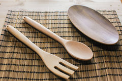 Wooden utensils on the table Stock Image