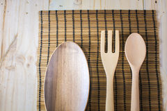 Wooden utensils on the table Stock Images