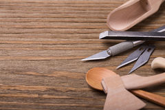 Wooden utensils and tools to create them Stock Image