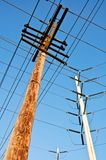 Wooden utility pole with power lines Stock Images