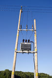Wooden Utility Pole with Power Lines and transformer Stock Photo