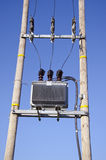 Wooden Utility Pole with Power Lines and transformer on sky Stock Photography