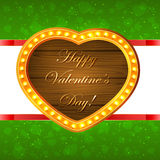 Wooden Valentines heart on green background Royalty Free Stock Photos