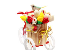 Wooden vase on a bike with a Birdy. Royalty Free Stock Photo