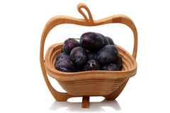 Wooden vase with black plum Stock Photos