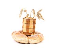 Wooden vase with ears of wheat and bread. Royalty Free Stock Photo