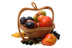 Wooden vase with fruit Stock Image