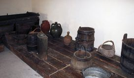 A wooden vat for grape-stomping, buckets and other antique household items in the basement of a traditional Bulgarian village hous. E, Silistra Province, the stock photo