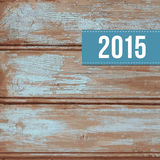 Wooden vector background with label 2015. Wooden vector background with old blue peeling paint and label with 2015 Stock Photo