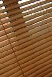 Wooden venetian blinds. Wooden venetian blind, jalousie or shutter half closed Royalty Free Stock Photo