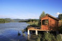 Wooden veranda on the mountain river Katun. Stock Image