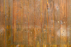 Wooden vertical brown planks. Horizontal background. Royalty Free Stock Photography