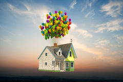 Wooden victorian house flying up Stock Photos