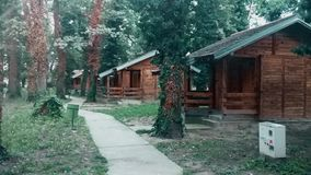 Wooden village with concrete footpath and old trees stock video