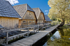 Wooden village on Gacka river Royalty Free Stock Photo