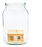 Wooden village house in glass jar Stock Images
