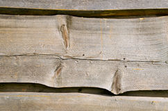 Wooden village house wall carved planks background Royalty Free Stock Photo