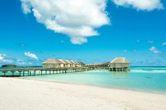 Wooden villas over water of the Indian Ocean. Maldives Stock Images