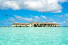 Wooden villas over water of the Indian Ocean. Maldives Royalty Free Stock Photo