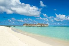 Wooden villas over water of the Indian Ocean. Maldives Royalty Free Stock Photos