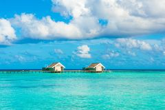 Wooden villas over water of the Indian Ocean Stock Photo