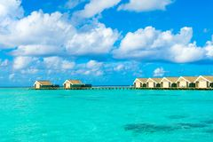 Wooden villas over water Stock Photo