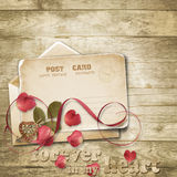 Wooden vintage background with valentines card. Stock Photography
