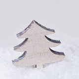 Wooden vintage christmas tree in snow Stock Images