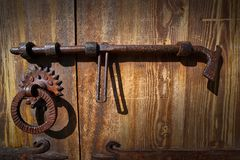 Free Wooden Vintage Door With Latch Rusty Lock Stock Images - 129983174