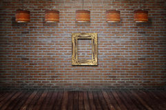 Wooden vintage frame beside the wall. Royalty Free Stock Images