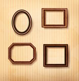 Wooden vintage frames on old wall. Stock Photo