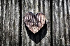 A wooden vintage heart on grunge wood planks. Love Royalty Free Stock Photo