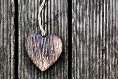 A wooden vintage heart on grunge wood planks. Love Royalty Free Stock Photos