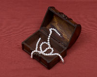 Wooden vintage jewelry box with freshwater white pearls Stock Photos