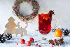 Wooden vintage rustic christmas decoration and hot mulled spiced red wine in glass mug Interior eco decor. Christmas or new year card stock photos