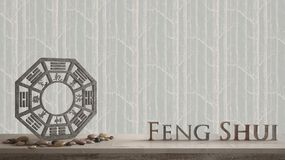 Wooden vintage table shelf with ba gua and 3d letters making the word feng shui with abstract forest background with copy space,. Zen concept interior design royalty free stock photos