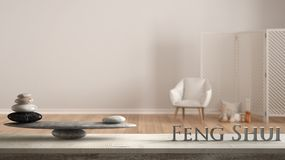 Wooden vintage table shelf with stone balance and 3d letters making the word feng shui over white background with armchair, screen. Candles and decor, zen stock photos