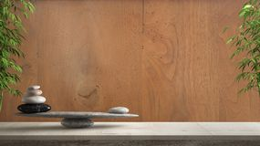 Wooden vintage table or shelf with stone balance, over vintage old wooden wall, feng shui, zen concept architecture interior desig. N stock photo