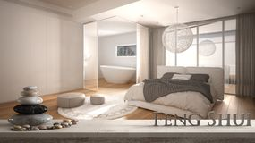 Free Wooden Vintage Table Shelf With Pebble And 3d Letters Making The Word Feng Shui Over Blurred Minimalist Bedroom With Bed, Bathroom Royalty Free Stock Images - 161779779