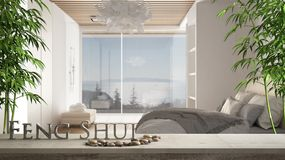 Free Wooden Vintage Table Shelf With Pebble And 3d Letters Making The Word Feng Shui Over Blurred Minimalist Bedroom With Double Bed, Royalty Free Stock Photos - 156964938