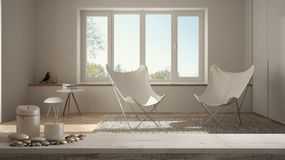 Wooden vintage table top or shelf with candles and pebbles, zen mood, over blurred empty minimalist white living room with panoram. Ic window, modern royalty free stock images