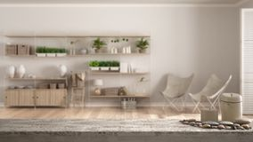 Wooden vintage table top or shelf with candles and pebbles, zen mood, over blurred empty room with vertical garden storage shelvin. G, white architecture stock image