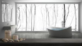 Wooden vintage table top or shelf with candles and pebbles, zen mood, over blurred gray bathroom with big panoramic window, white stock photo