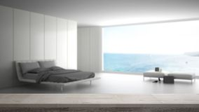 Wooden vintage table top or shelf closeup, zen mood, over blurred minimalist bedroom with big window on sea panorama, white archit stock photos