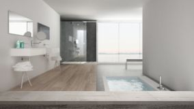 Wooden vintage table top or shelf closeup, zen mood, over blurred minimalist white bathroom with bath tub and panoramic window, wh. Ite architecture interior stock image