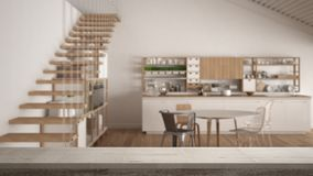 Wooden vintage table top or shelf closeup, zen mood, over blurred white wooden kitchen, loft with stairs, white architecture inter. Ior design Royalty Free Stock Image
