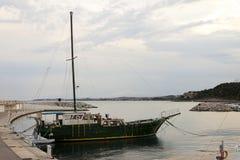 Wooden vintage vessel mooring on the pier in Roc de Sant Gaieta. Royalty Free Stock Photos